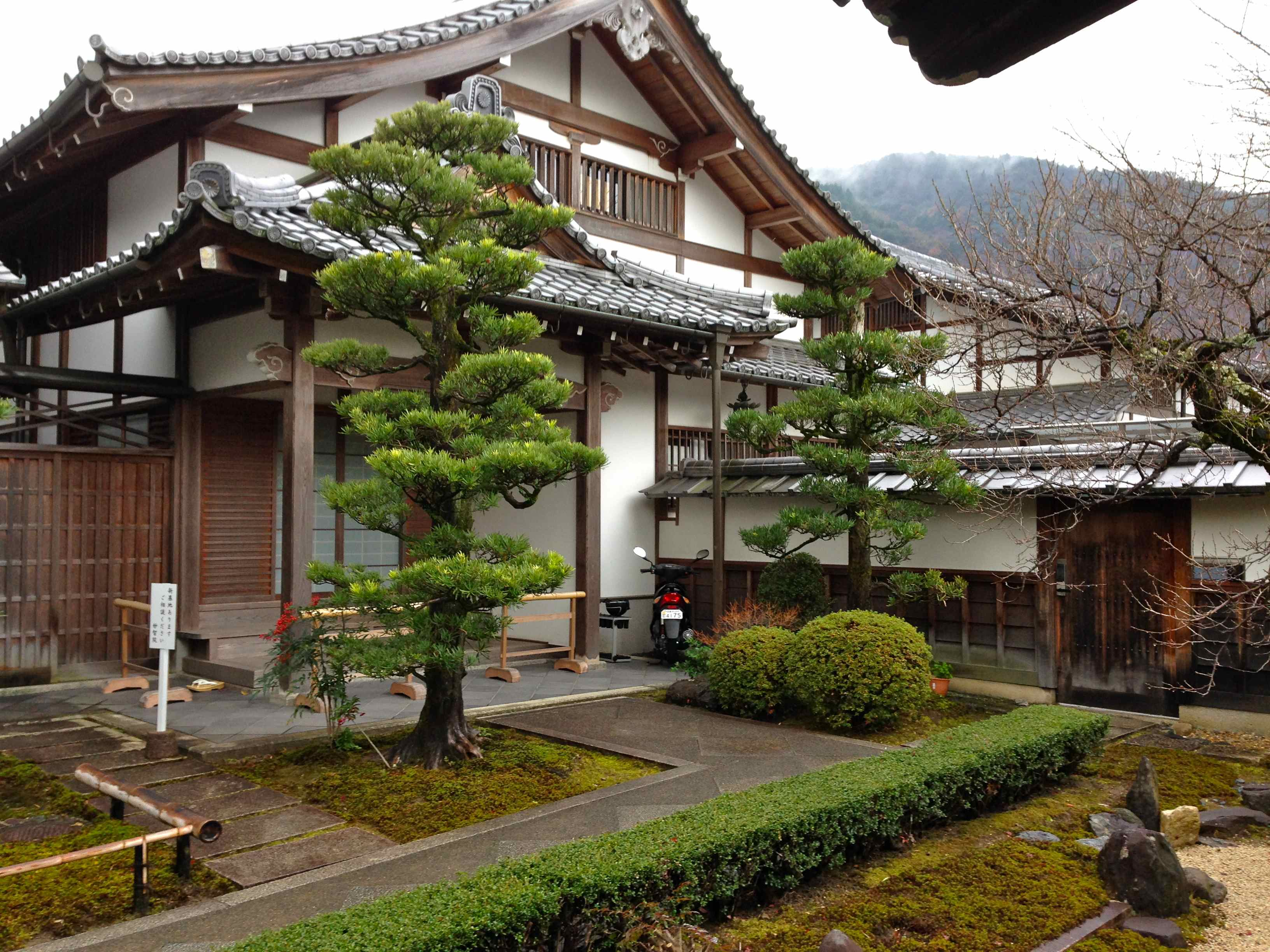 Traditional Japanese Building Inside A Garden In Arashiyama