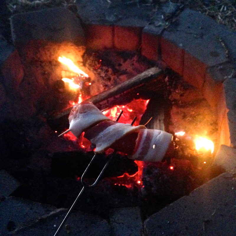 bacon wrapped hot dogs campfire camping